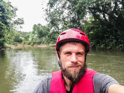Man with red helmet on a kayak in Ecuador