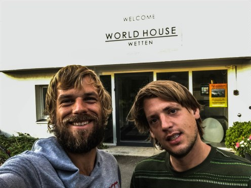 Two blonde men in front of the World House Wetten