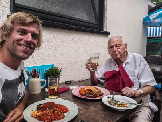 A blonde German man having lunch with his grandfather