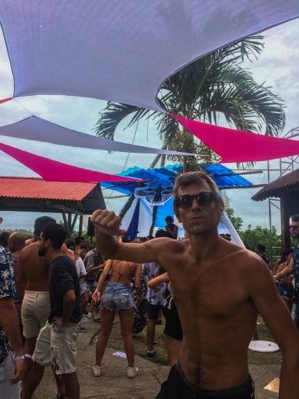 Blonde man dancing on a Psychedelic trance festival in Ecuador