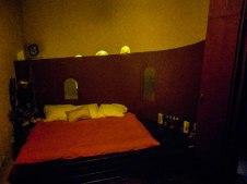 bed in slightly dark room