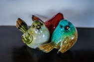 three porcelain birds