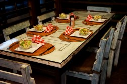 Dinning table with 5 plates during nighttime