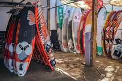 Many surf board on the wall