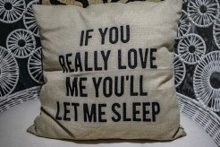 """""""If you really love me you'll let me sleep"""" written on a pillow"""