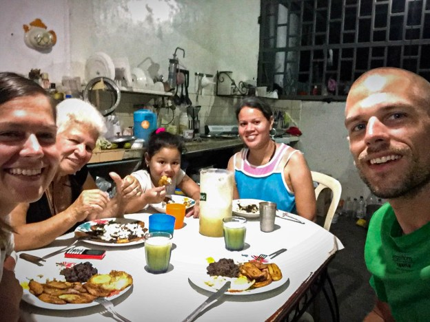 A family eating at home while Couchsurfing