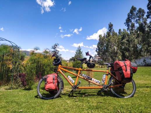 Velotraum tandem bicycle with Ortlieb panniers, water bottles and helmets in the nature