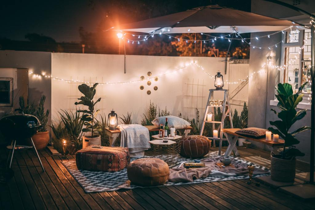 Porch decorated with lights and dinner for a date night for a couple to spend time together