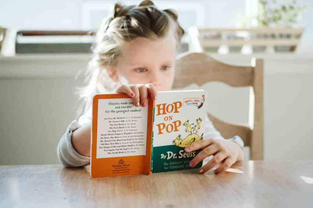 Young girl reading a book, Hop on Pop