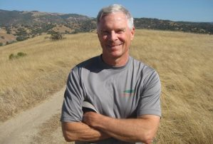 Photo of Gary Dudney, runner and writer, high atop a ridgeline near his home in Monterey County, California