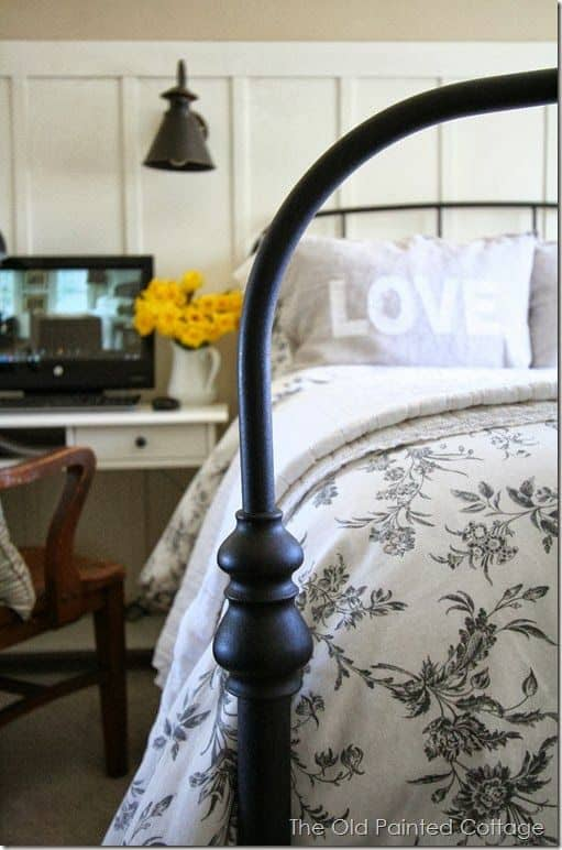 The modern farmhouse staple: the antique black bed to complete your bedroom makeover.