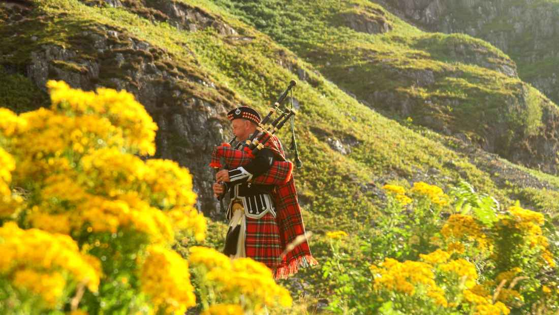 Bagpiper in full Scottish attire