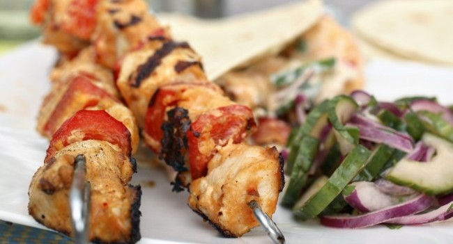 chicken satay sticks with cucumber salad