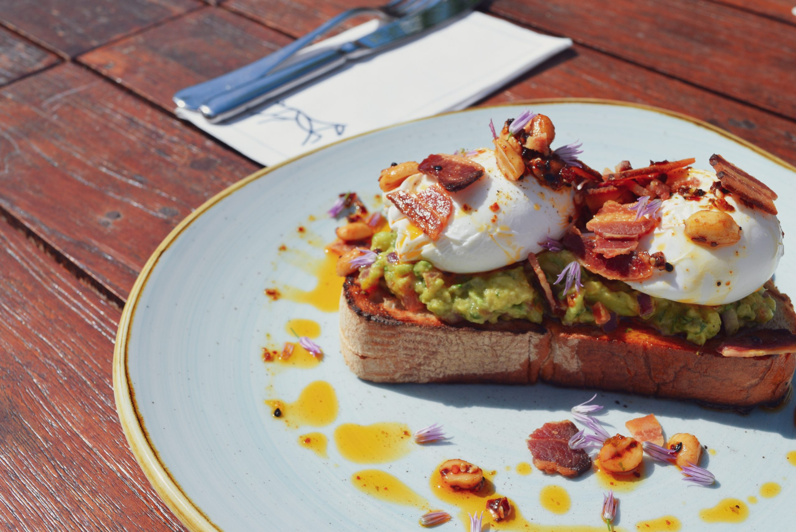 Mikey Ryan's Avocado & Poached Eggs on Toast with Peanut Rayu and Crispy Bacon by Chef Stephen Hayes