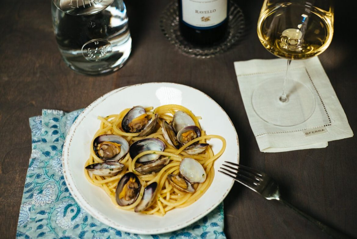Pasta with clams are paired with Marisa Cuomo Ravello Bianco wine