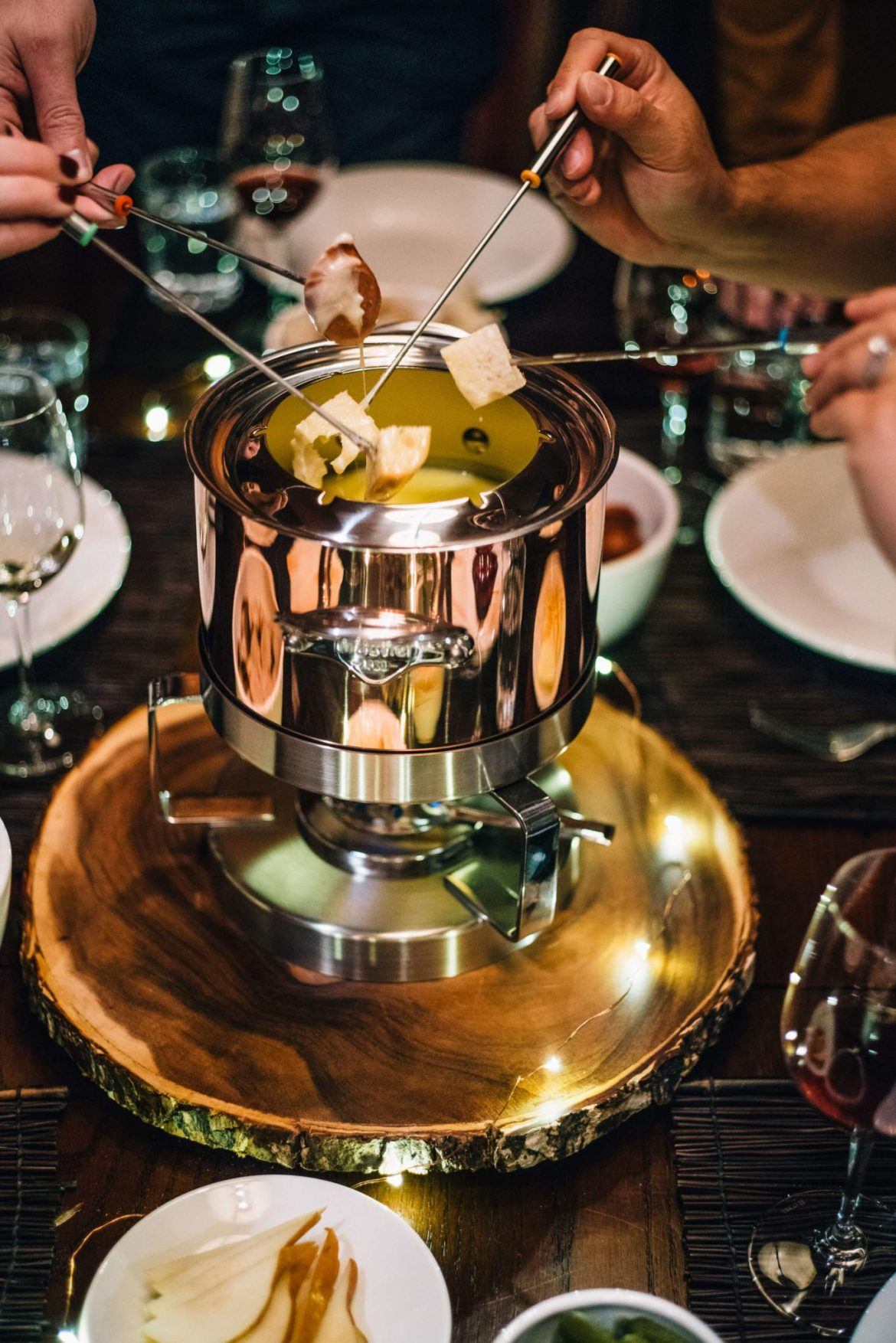 Friends at a apres ski fondue Party with Mauviel on the taste edit in tahoe - see how to make the fondue recipe here