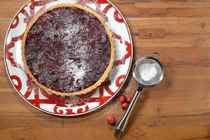simple cranberry tart on hermes platter