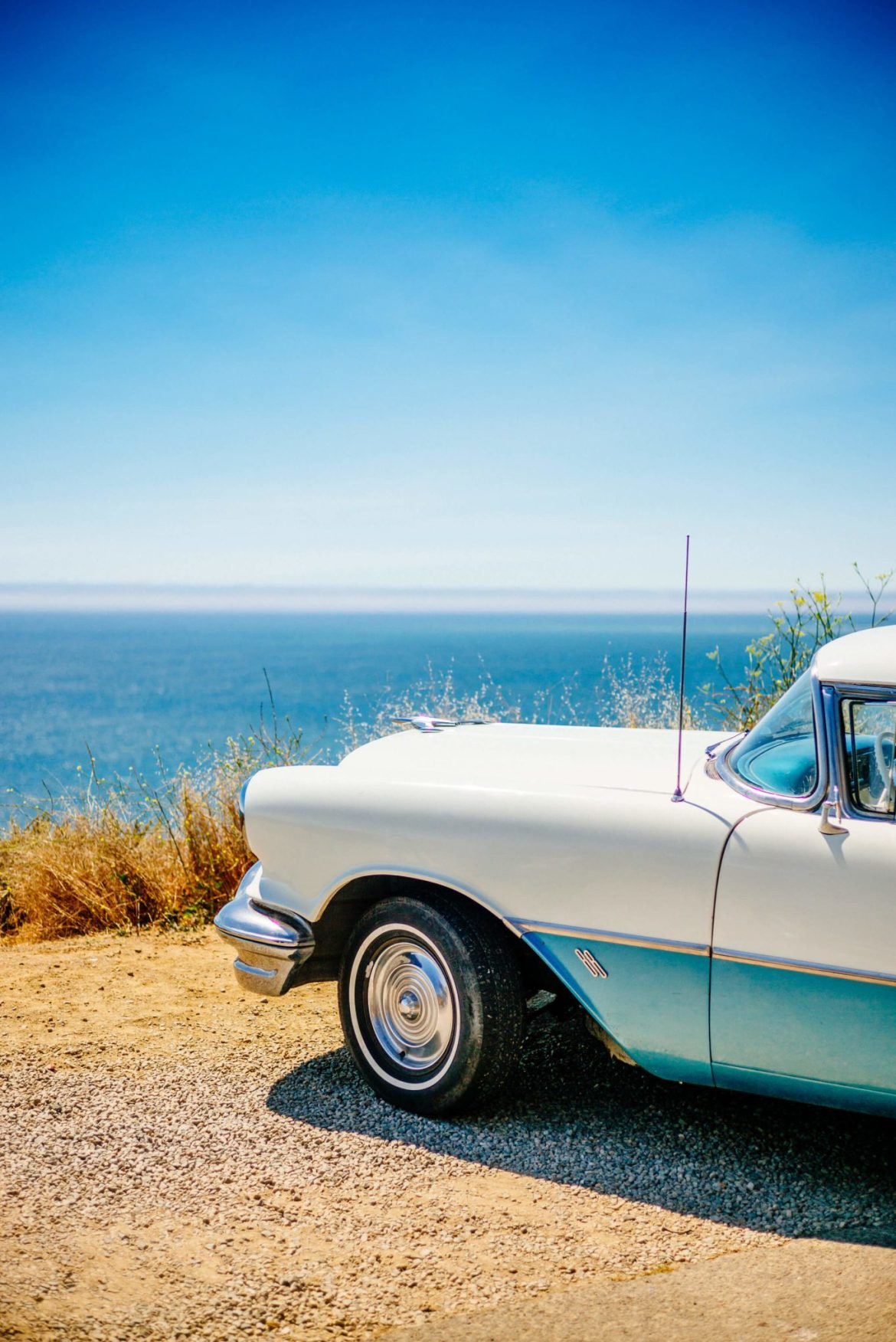 The Taste Edit spots an antique car overlooking the Pacific Ocean on highway one California coast.