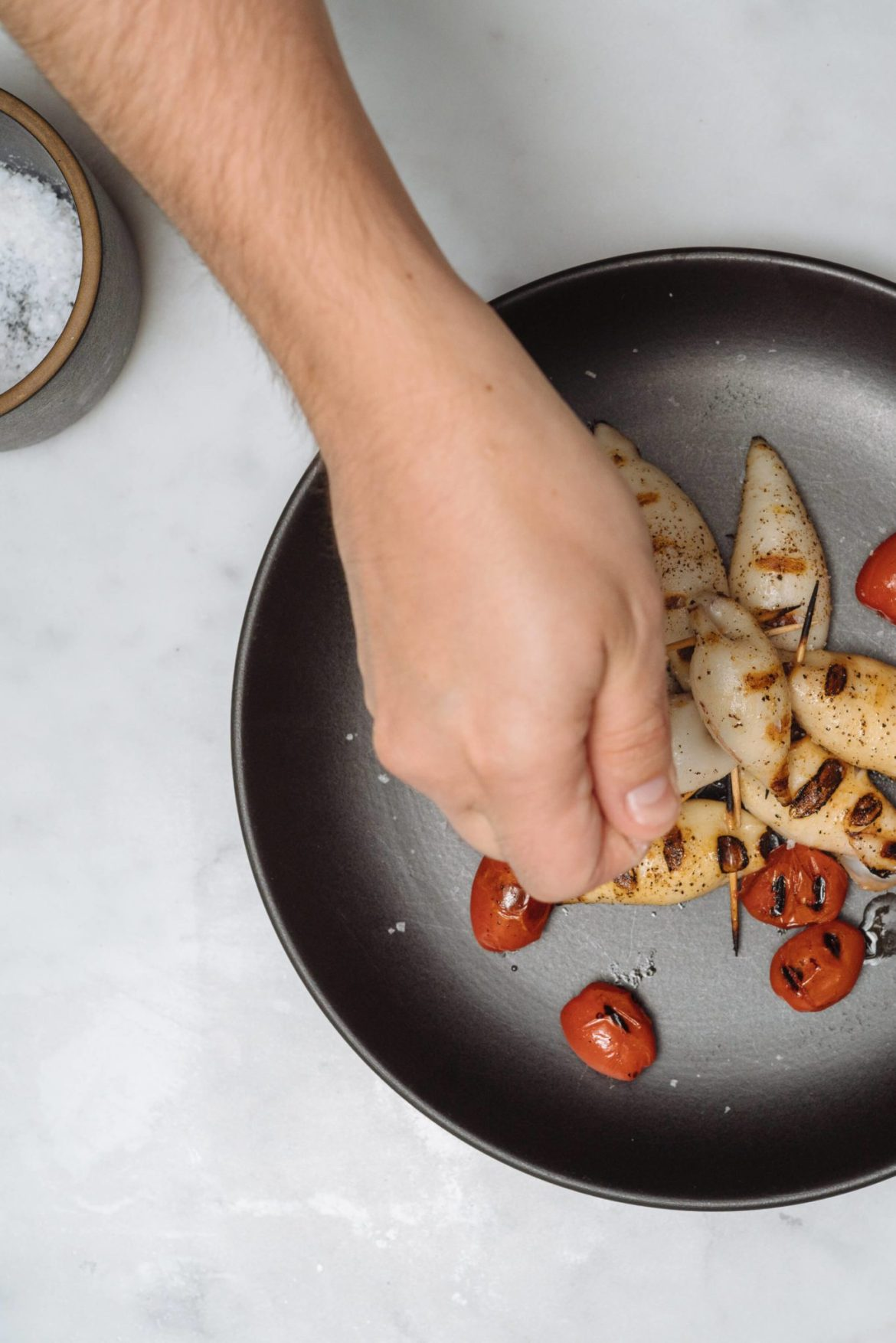 Topping our stuffed squid with salt