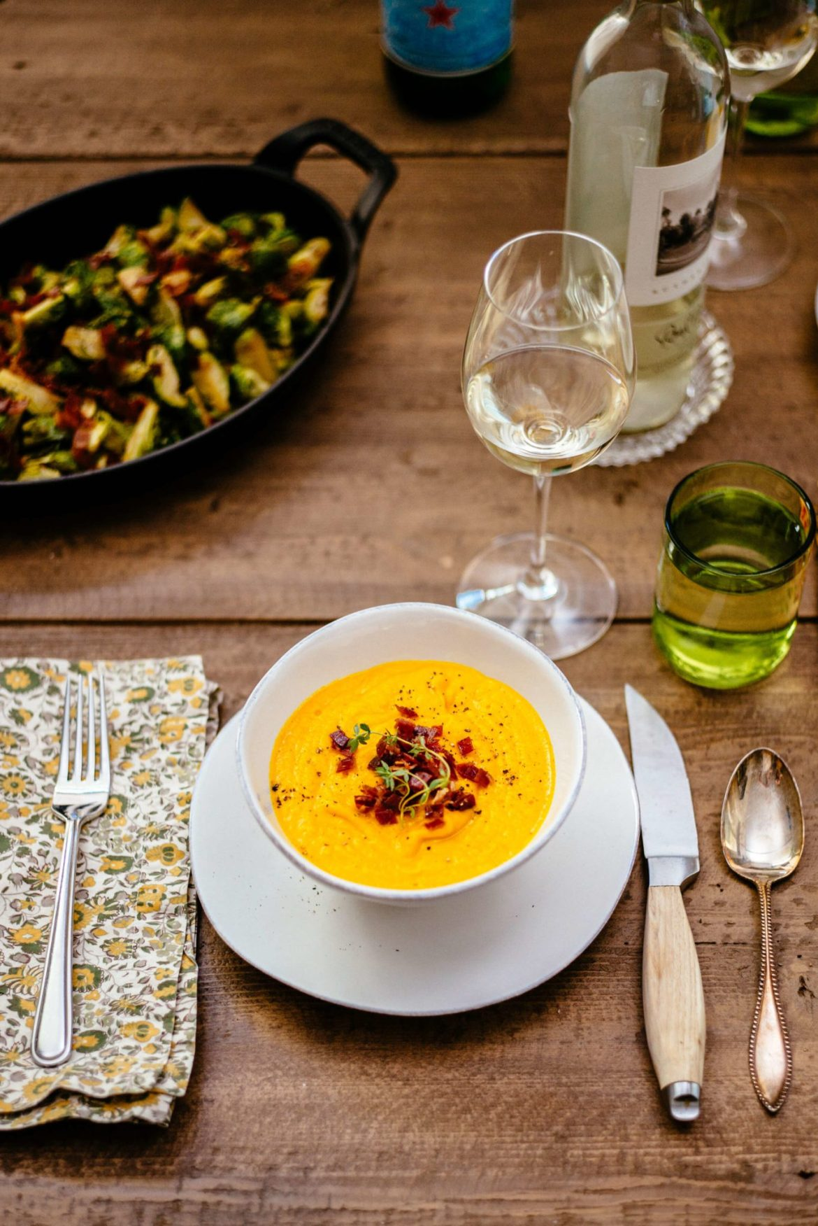The Taste Edit serves Roasted Kabocha Squash Soup with Crispy Prosciutto paired with round pond sauvignon blanc at thanksgiving and spic roasted brussels sprouts
