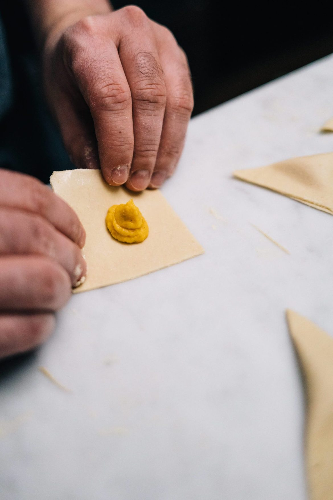 Folding pasta to make agnolotti in How to Make pasta at home with The Taste Edit and KitchenAid