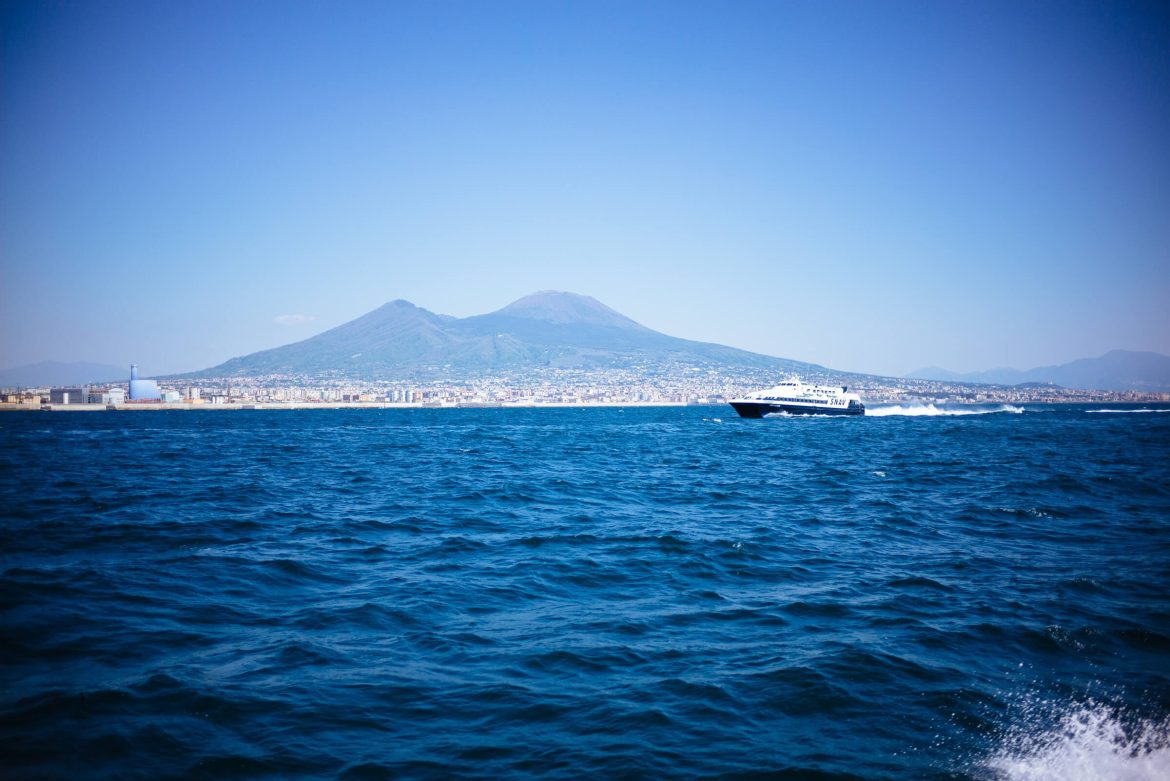 Use highspeed ferries to get around the Amalfi Coast in Italy. Mount Vesuvius from the high speed ferry from Napoli to Capri