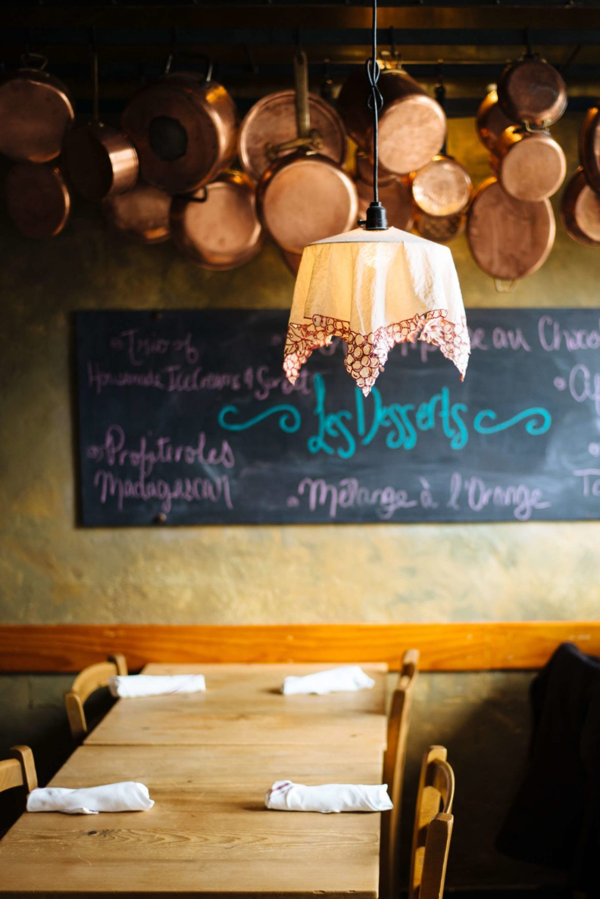 Looking for one of the best restaurants in Carmel, try La Bicyclette - it has tons of copper pans hanging from the ceiling and chalk boards on the walls for daily specials, thetasteedit
