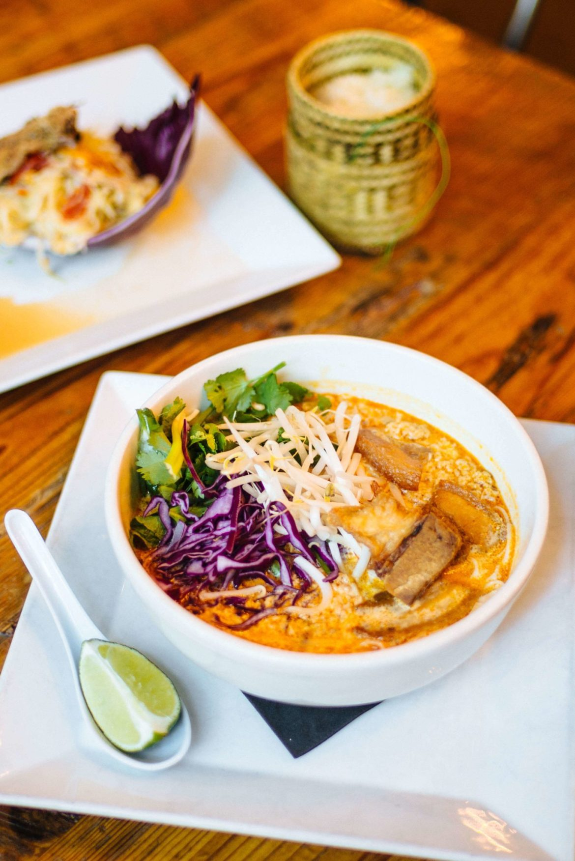 Try the Crispy Pork Belly soup and the Green Papaya salad, at Bida Manda one of the best Asian restaurants, go to this Laotian Bar and Restaurant in Raleigh NC thetasteedit