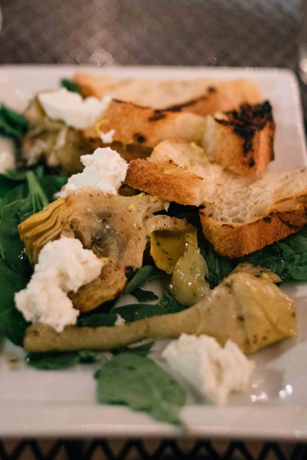 Photographers and bloggers from The Taste Edit visited one of the best restaurants in Albuquerque - Farm and Table. Try this small plate of artichoke hearts, ciabatta, and goat cheese.
