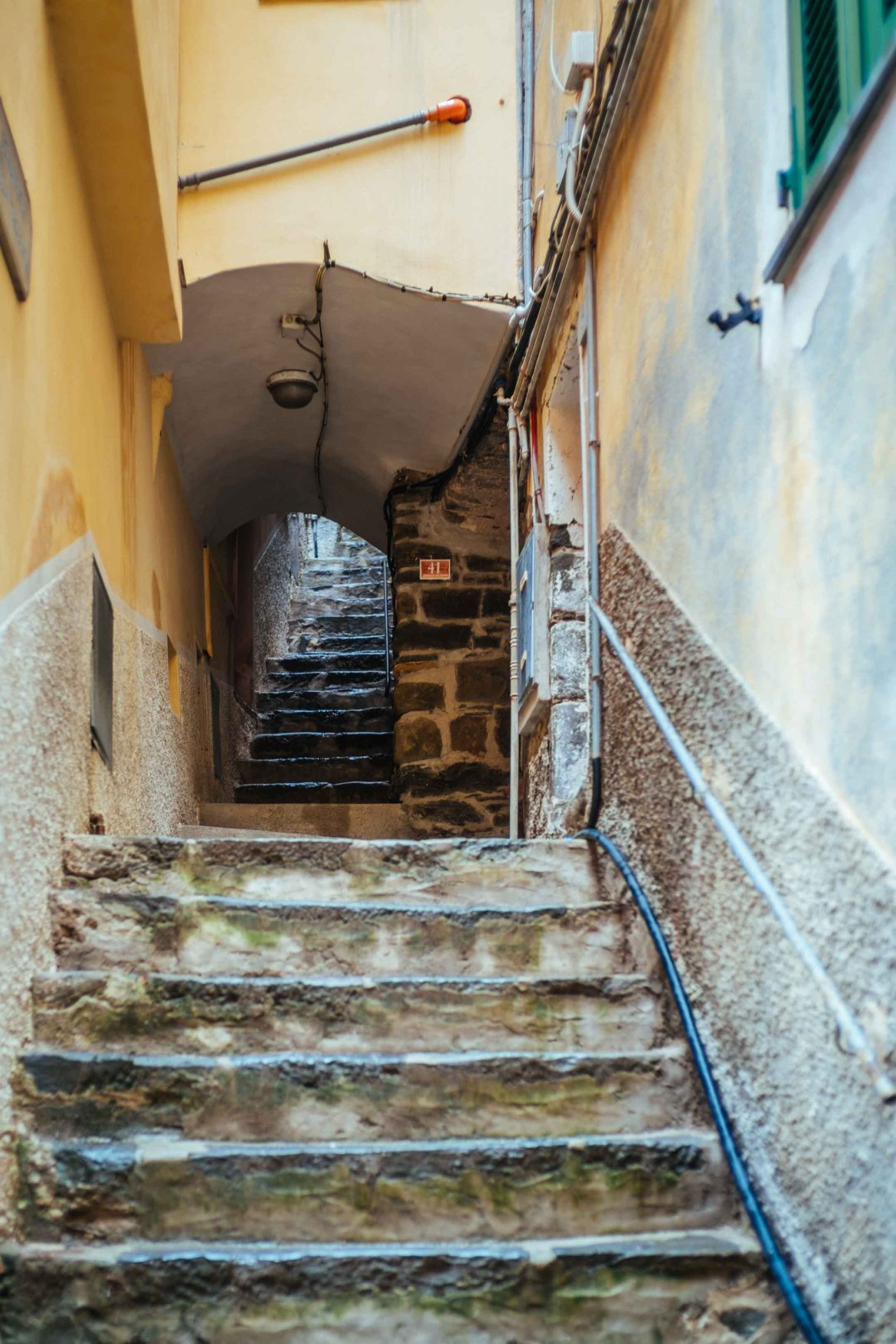 Cinque Terre is one of the most popular vacation destinations in Italy, The Taste Edit recommends finding places that are different and local during your trip. Find little staircases as you walk around the town exploring like a local.