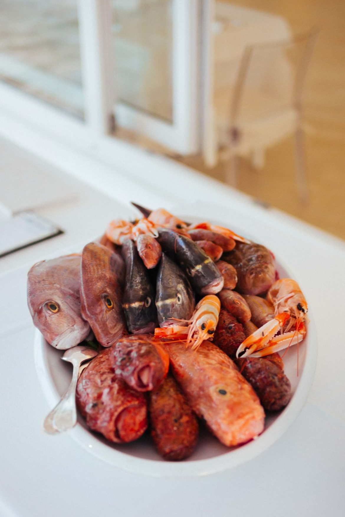 Fresh local fish and shellfish is served to order at the Sale Blu restaurant located at the luxury Puglia hotel La Peschiera  just south of Monopoli, Italy, The Taste Edit t