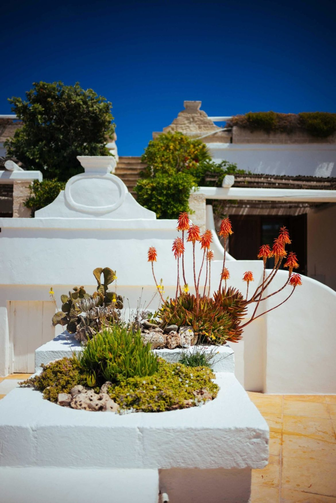 White washed walls, multiple pools, ocean views, and gardens will create an exclusive getaway vacation the luxury Puglia hotel La Peschiera near Monopoli, Italy, The Taste Edit