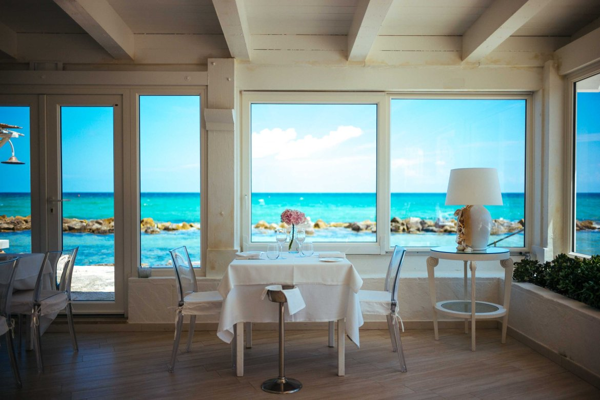 Plan a romantic getaway at a luxury hotel in Puglia - this view of the sea is taken from the Sea La Peschiera restaurant, a perfect table for two and a view