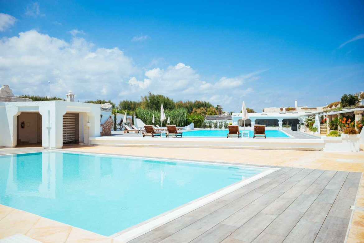 Lay by one of the multiple blue pools at the luxury Puglia hotel La Peschiera  just south of Monopoli, Italy, The Taste Edit