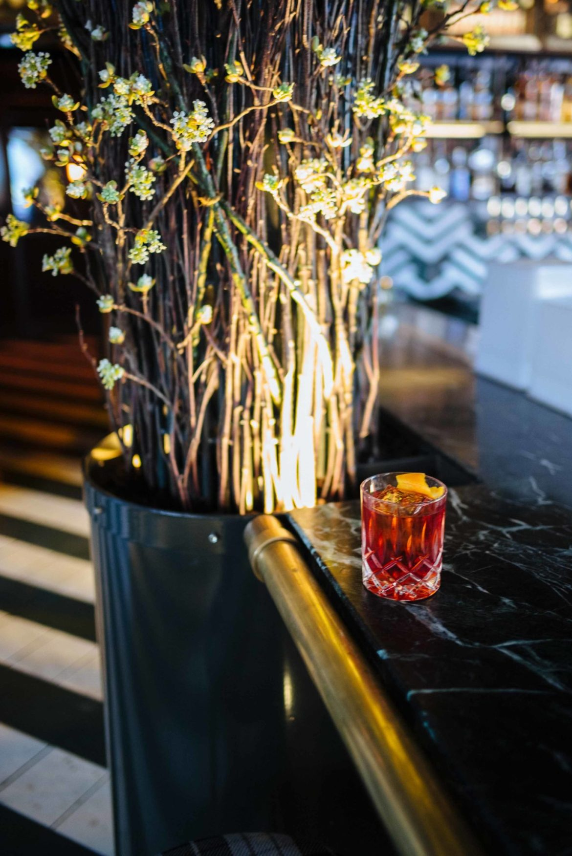 over-the-top steakhouse at Born and Raised with classic cocktails like Negroni at their rooftop bar in San Diego
