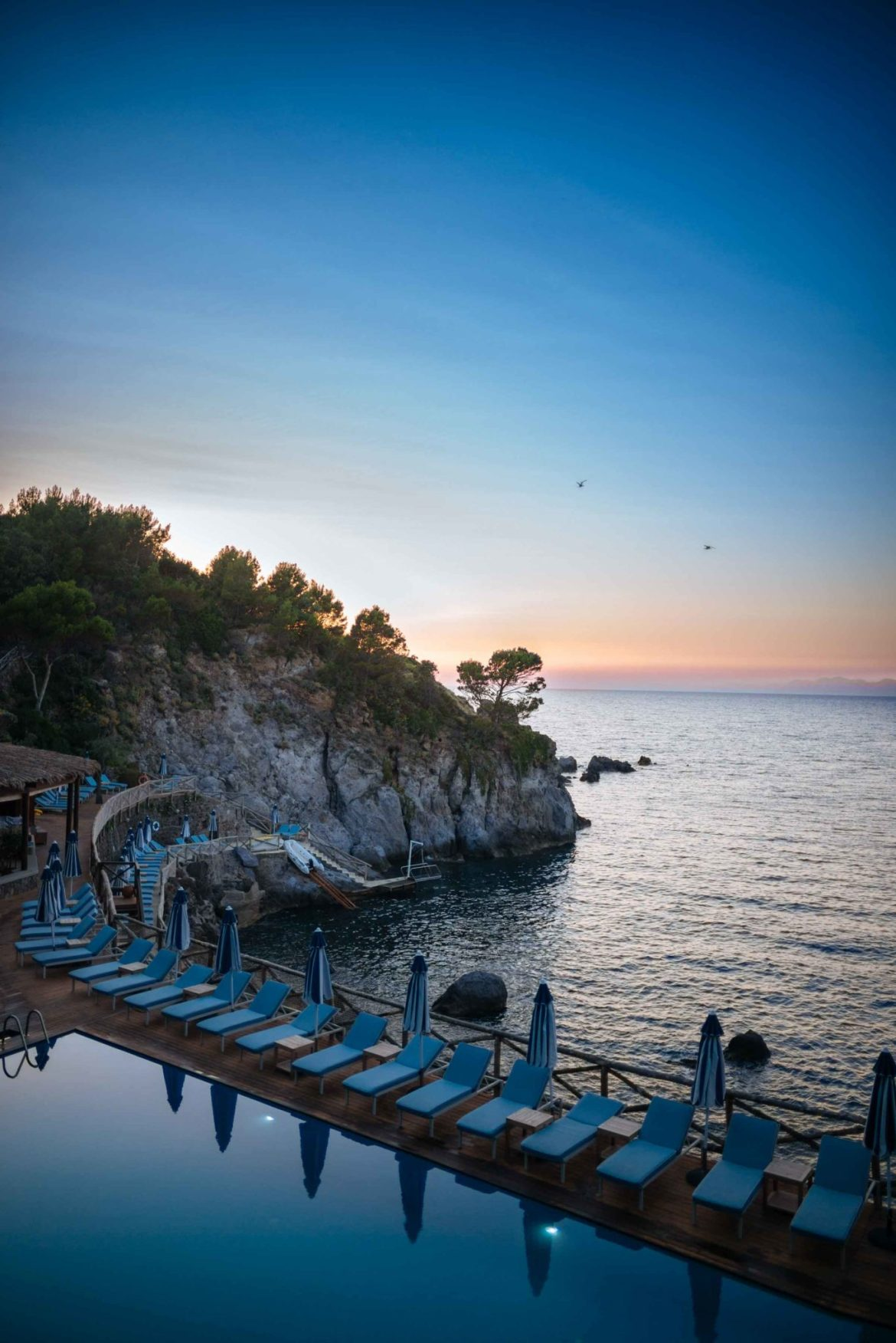 Dinner at the Mezzatorre Hotel's La Torre overlooks the seawater pool and the sea at sunset each evening in Ischia. Photo by The Taste Edit, Sarah Stanfield