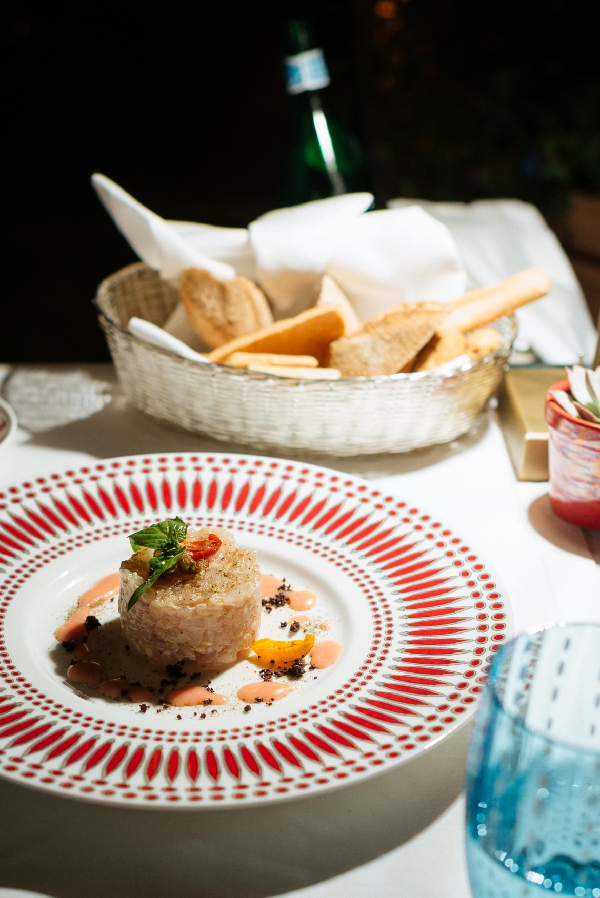 The Mezzatorre Hotel in Ischia's La Torre restaurant serving red snapper crudo on a custom Villeroy & Boch chilipeper dish and zafferano glasses. Photo by The Taste Edit, Sarah Stanfield