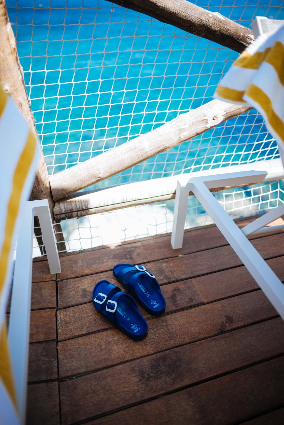 The must-have sandal this summer in Italy's Amalfi Coast. This summer, these chic Il Dolce Far Niente Birkenstocks were all the range in Italy made with navy rubber perfect for the pool or beach.