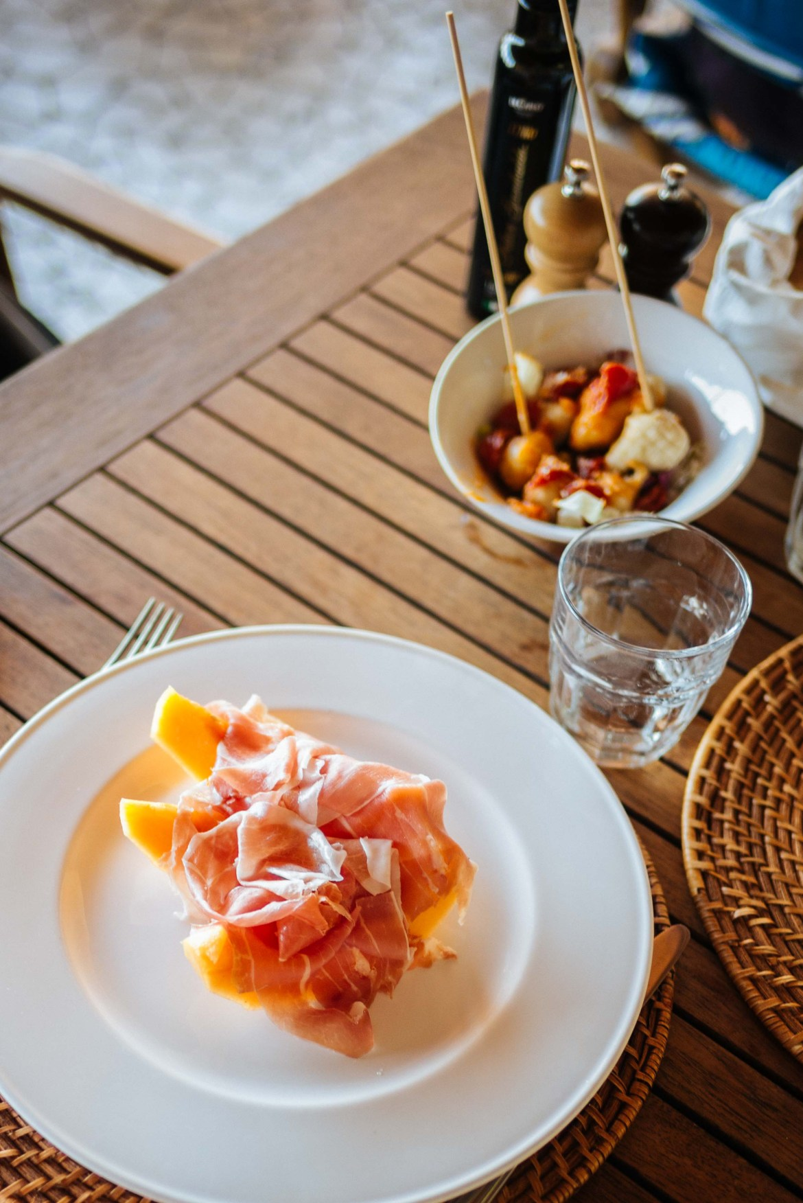 The Taste Edit, Sarah Stanfield orders refreshing melon and prosciutto at lunch time by the pool at Mezzatorre's La Baia restaurant