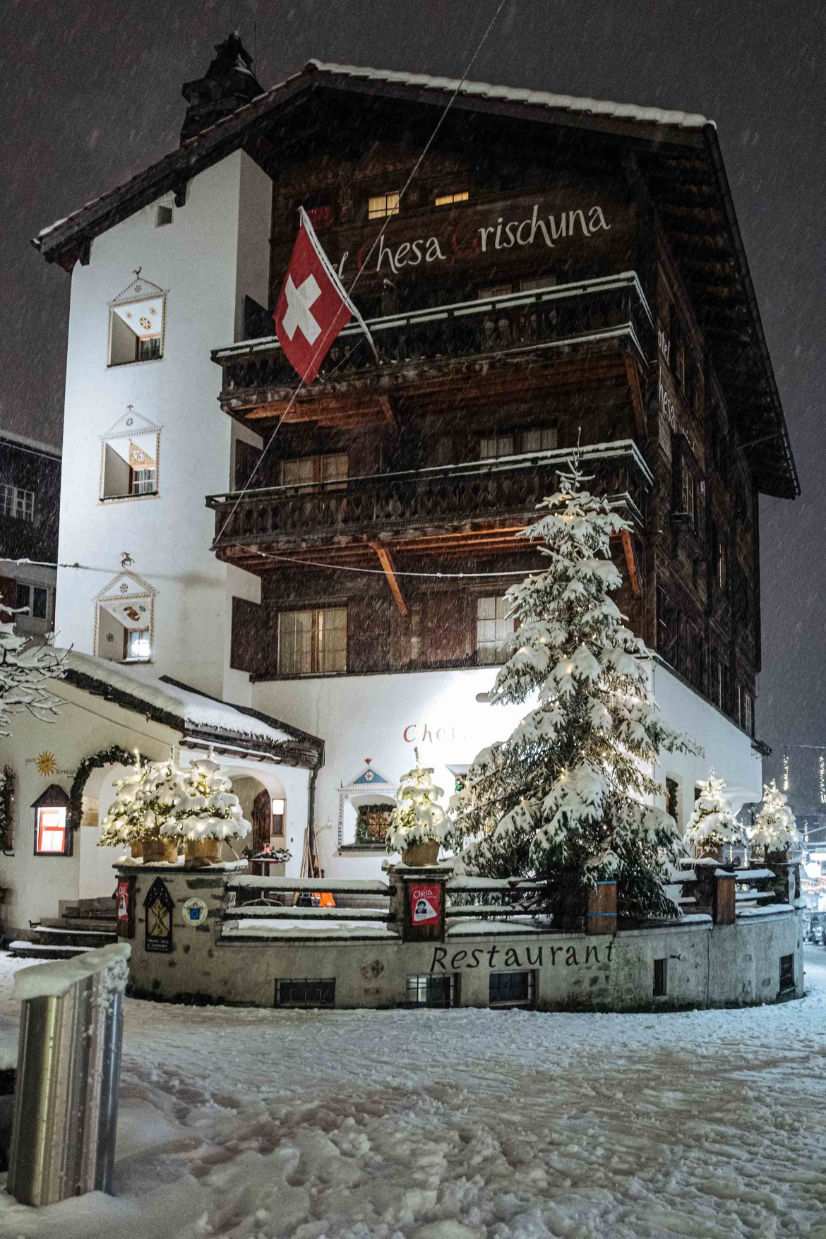 When planning your ski vacation to Klosters, stay at the Klosters Hotel chesa grischuna near Davos with historic architecture and alpine charm | The Taste Edit #travel #switzerland #swiss #snow #hotel