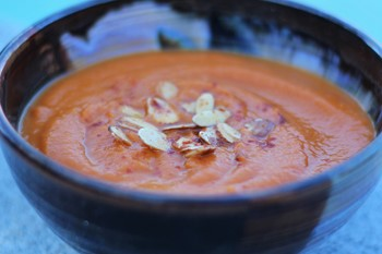 Caramelized Carrot and Ginger Miso Soup with almonds and pomegranate