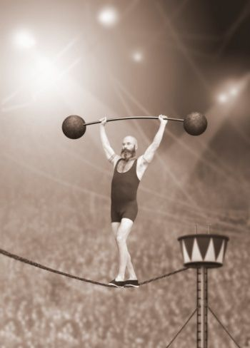 tight rope walker lifting weights