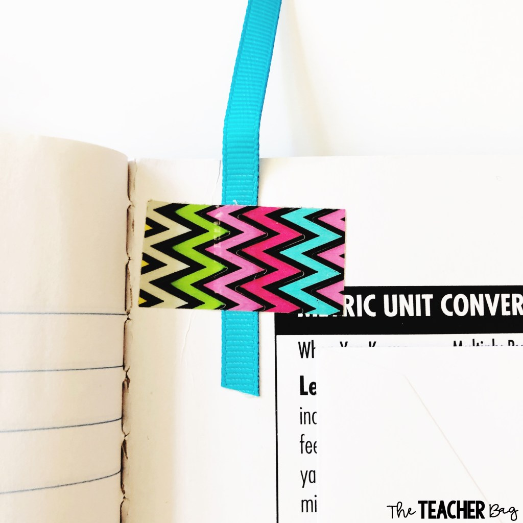 tape of ribbon bookmark on a composition notebook
