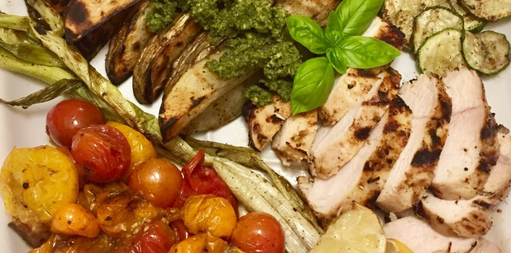 Grilled Lemon Chicken with Blistered Heirloom Tomatoes, Summer Vegetables and Pesto Potato Wedges