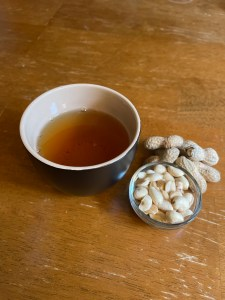 Peanuts and a cup of The Tea In Me Fairground Flashback tea