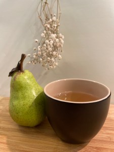 pear and a cup of The Tea In Me Ice Wine Archetype tea