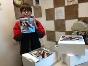 thomas-picking-up-first-order-of-books-10-28-16