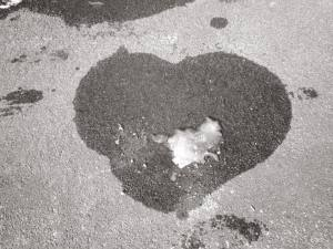 Melting Snow Heart on Pavement