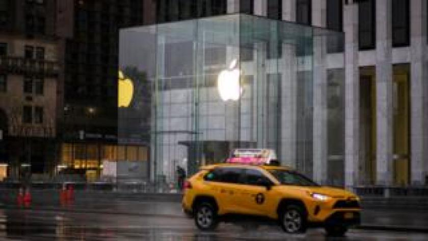 A taxi drives past Appl's headquarters in New York