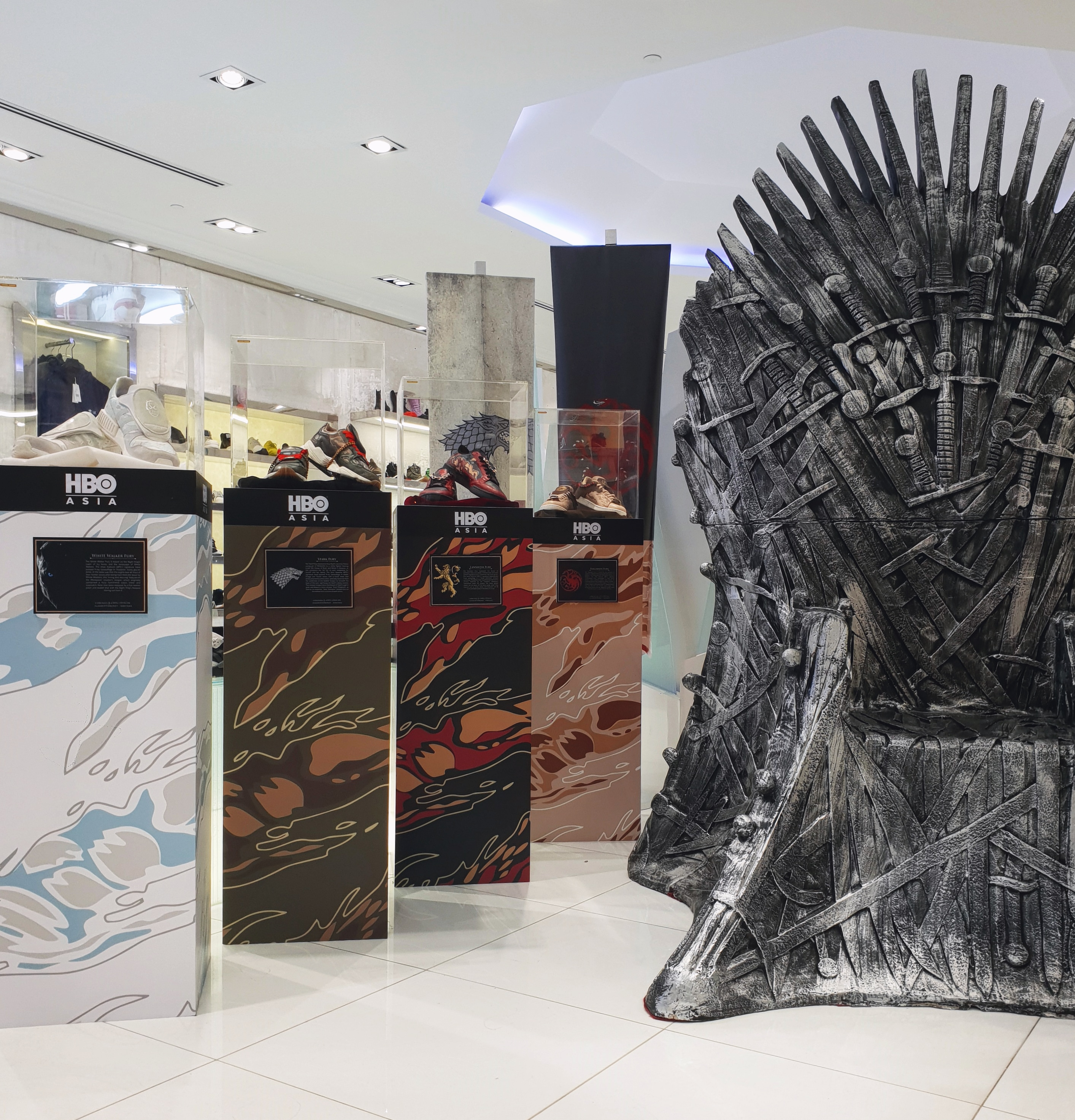 GOT Sneakers on display with Iron Throne